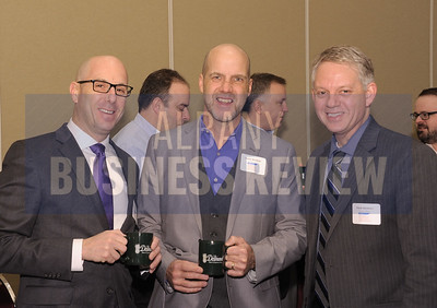 David Hollander of Sano-Rubin Construction Services, left, with Daniel Woodside of CSArch and Frank Sarratori of Pioneer Bank.