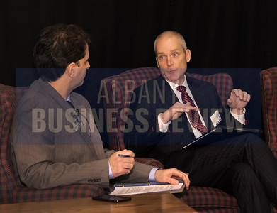 Senior reporter and moderator Michael DeMasi  with panelist Tom Amell, president and CEO of Pioneer Bank
