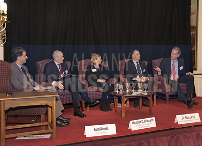 Senior reporter and moderator Michael DeMasi, left, with panelists Tom Amell, president and CEO of Pioneer Bank; Heather Briccetti, Esq., president and CEO of The Business Council of New York State; Dr. Don Levy, director of the Siena College Research Institute and George Vorsheim, director of communications and marketing communications for Environment One Corporation (E/One).