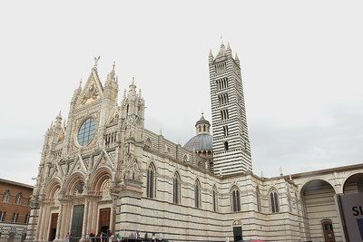 Siena Cathedral is a medieval church in Siena, Italy. The cathedral itself was originally designed and completed between 1215 and 1263 on the site of an earlier structure. It has the form of a Latin cross with a slightly projecting transept, a dome and a bell tower.  from:  https://en.wikipedia.org/wiki/Siena_Cathedral