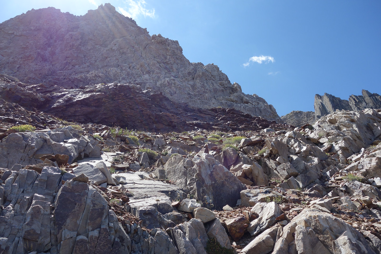 Horizontal red rock.  A ramp at it's bottom dumps us off in the narrow chute.  Note the jagged rock formation on right.