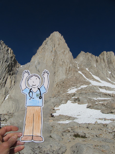Stan Tall holding up Mt. Whitney