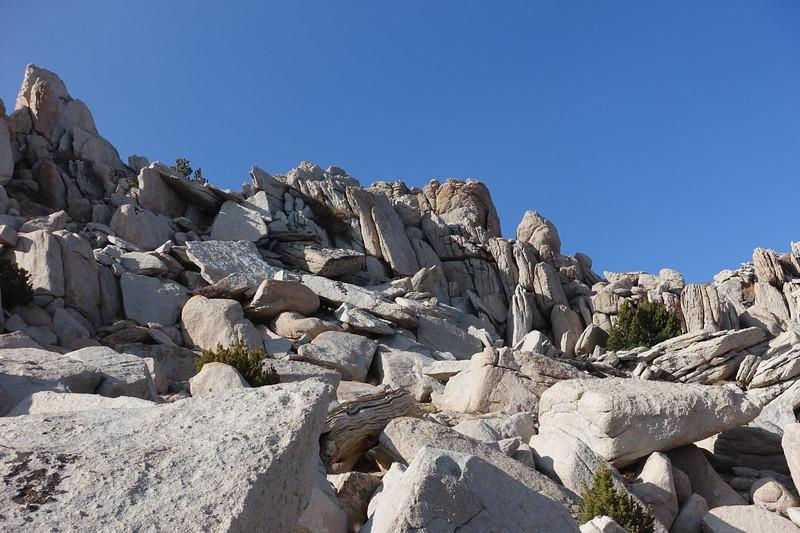 Summit is the orange rock.