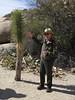 Ranger and young yucca brevifolia--Joshua tree,