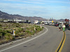 Route 66 railroad rossing, by Amboy - traffic waits for a rare stopped train