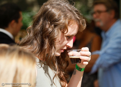 Rachael Hetts smells the special Sierra Nevada wine that was brewed using Maisie Jane's almonds during the Sierra Oro Farm Trail Passport Weekend Saturday October 8, 2016 in Chico, California. (Emily Bertolino -- Enterprise-Record)