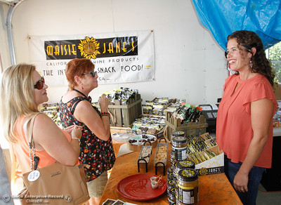 Maisie Jane Hurtado, right, talks about how she started Masie Jane's as an FFA student looking for a new way to brand almonds as guests visit during the Sierra Oro Farm Trail Passport Weekend Saturday October 8, 2016 in Chico, California. (Emily Bertolino -- Enterprise-Record)