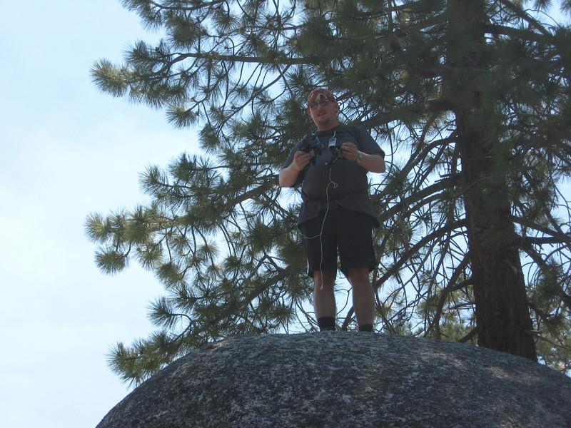 Nathan on a boulder