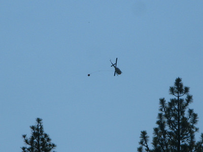helicopter getting water from the Merced - controlled burn near Glacier Point