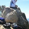 Tara sitting on the summit block