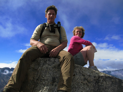 Tom and Kathy sitting on Harley summit block