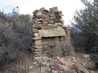 stone fireplace just below the peak