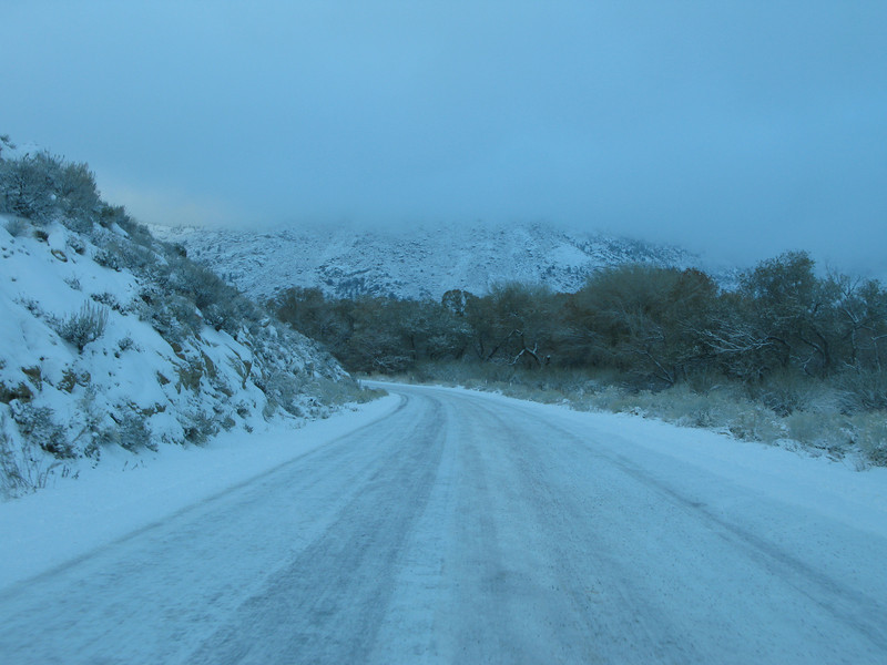 the road has some snow and ice