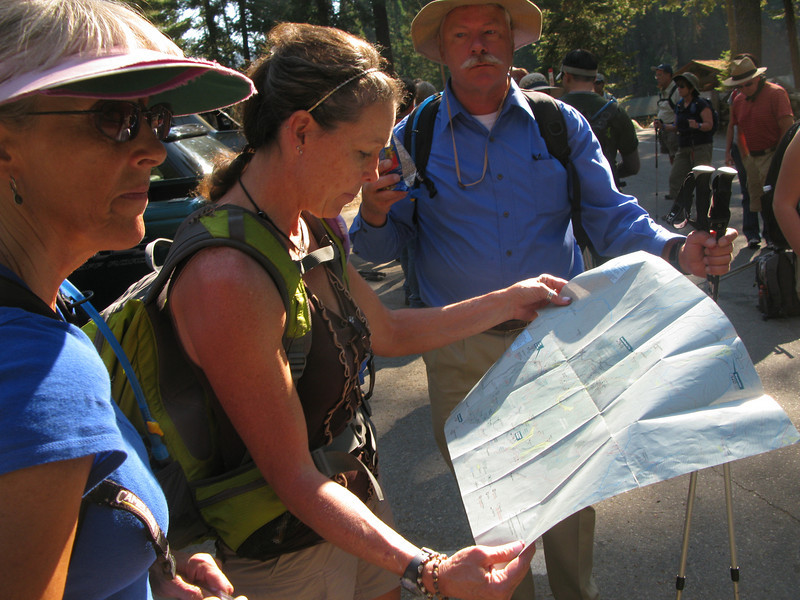 Lisa and Alice will lead the trip - they are studying the map.