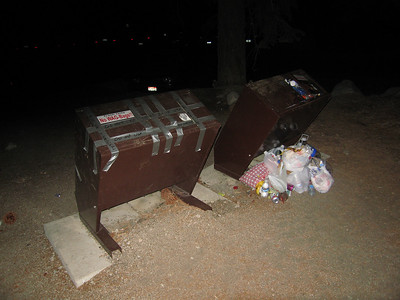 unable to use the one beside it - probably taped up due to a malfunction - we saw a bear get in the backside of the taped up one a few weeks ago - probably a defective latch