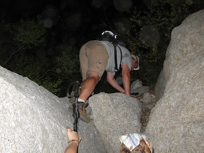 Don getting up over the rock above