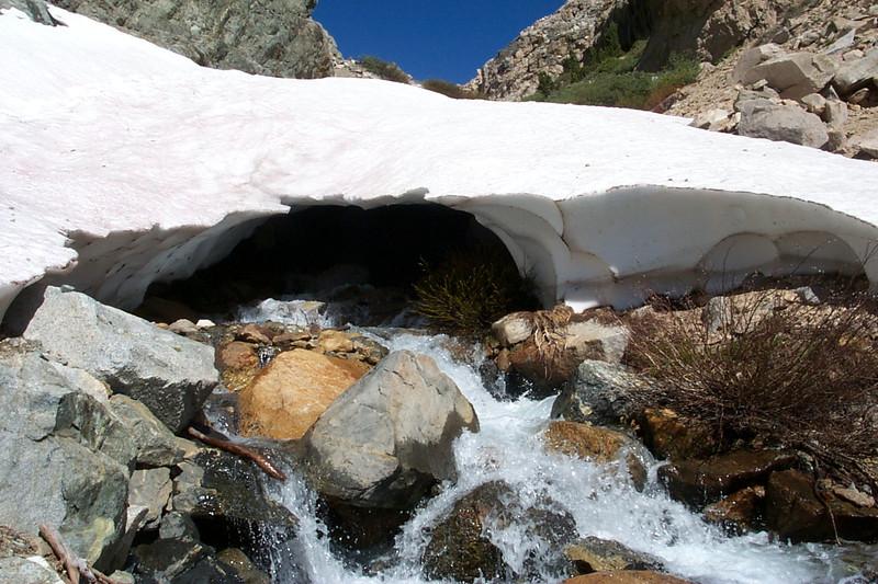 Snow bridge over the stream.
