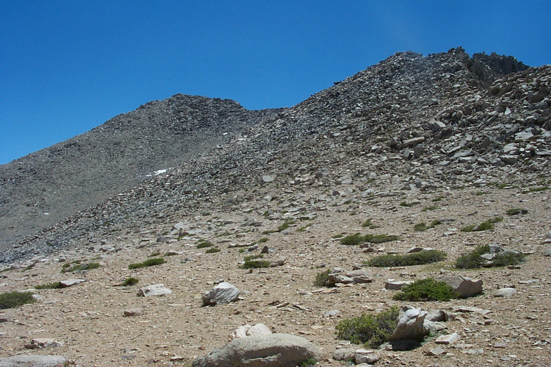 My first good view of Kearsarge Peak, the one on the left. My plan is to traverse the slope as I climb up to the peak. The ridge leading to the peak is covered with very large rocks make it a bad route. .