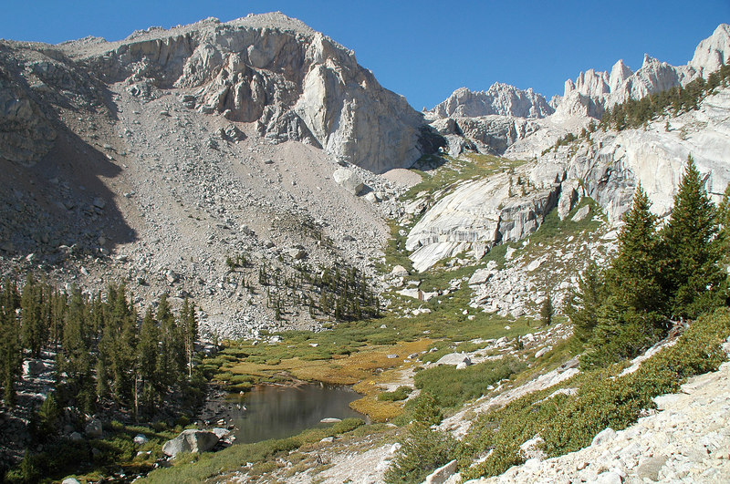 Looking back at the lake and Thor Peak. The Mountaineer's Route follows the green canyon.