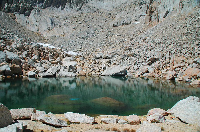 Little no name lake at 12,250' with what looks like someone's blue tent in it. The lake is only about a 100' across.