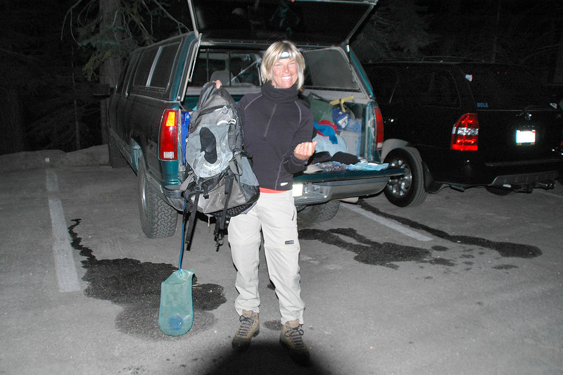 Sooz with her torn pack after we got it back from a young bear that ran off with it when she wasn't looking just before we were about to start the hike at about 5:00am.