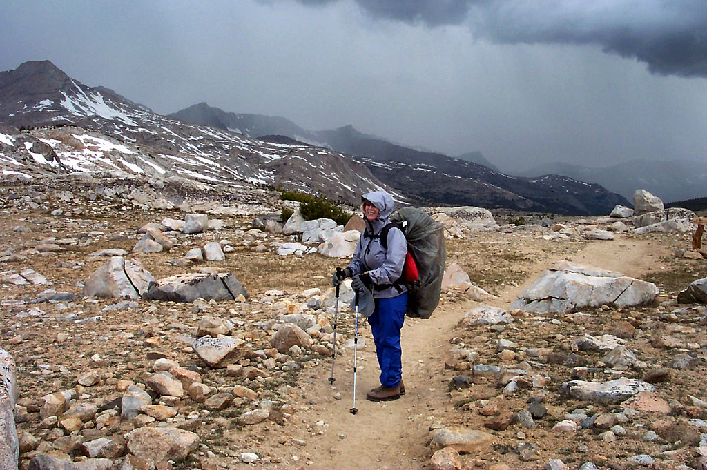It's raining. Kathy and her pack are ready for the rain that we hiked in for the next couple of hours.