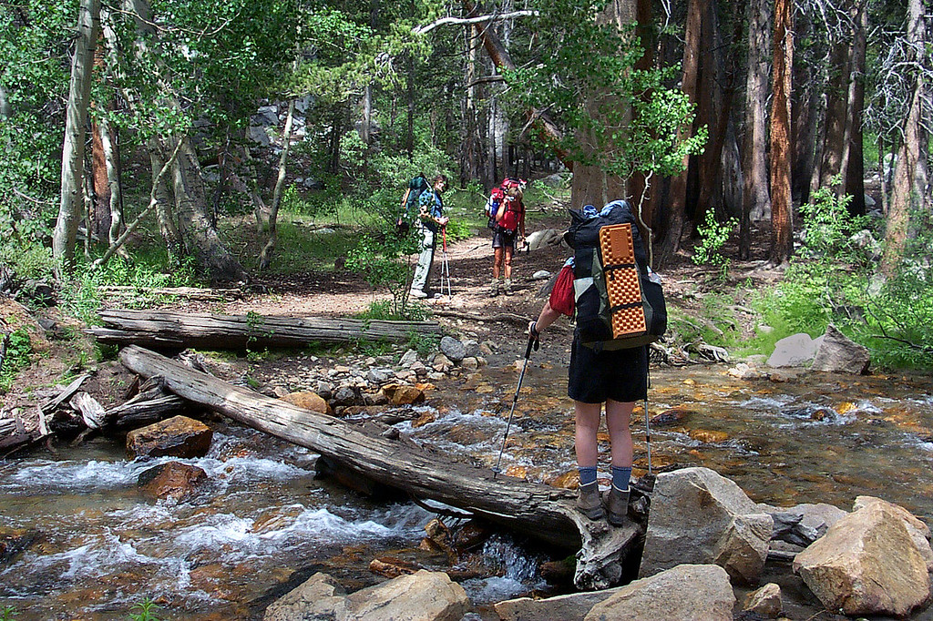 Kathy about to cross the first stream while Earnie and Sooz wait on the other side.