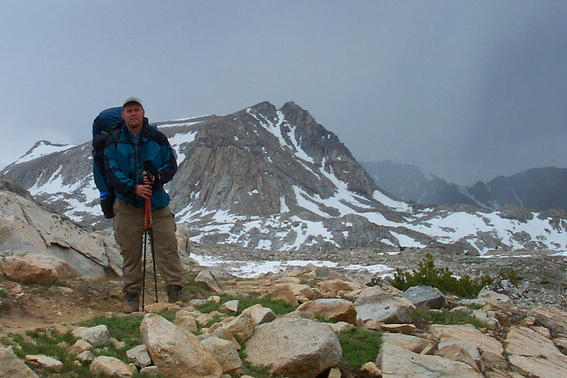 Andy with Muriel Peak. After taking a snack break and putting on the rain gear we hiked on towards Mesa Lake where we should meet up with John.
