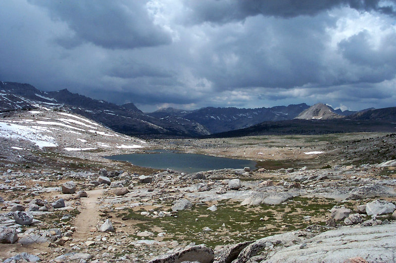 A view of Summit Lake to the west from Piute Pass at 11,423 feet. Not only are those clouds dark, we could hear thunder. All of us put on the rain gear.