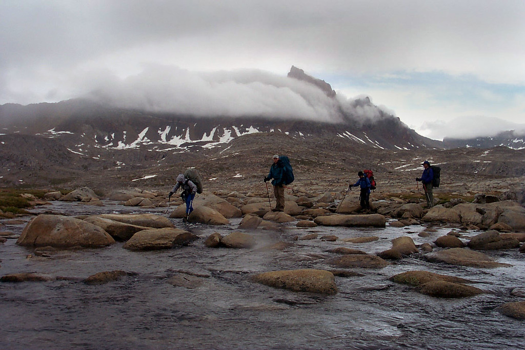 Crossing the outlet stream from Desolation Lake. A cloud shrouded Mount Humphreys in the background.