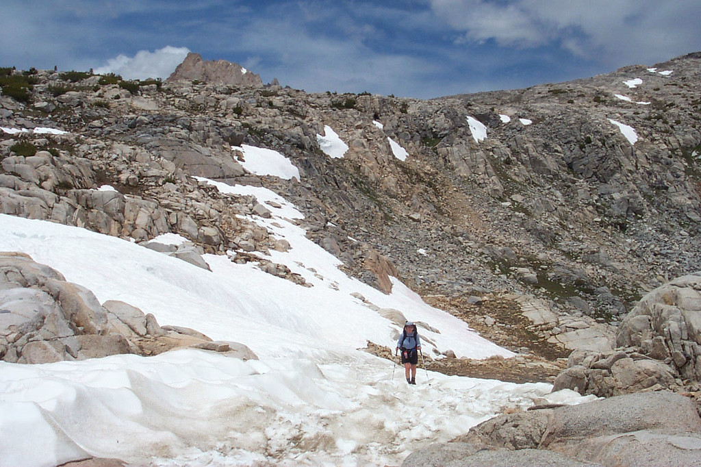 Kathy on the snow, almost to the pass.