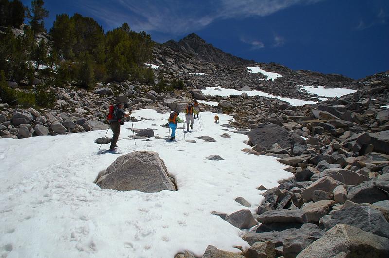 Climbing a snow patch towards the peak.
