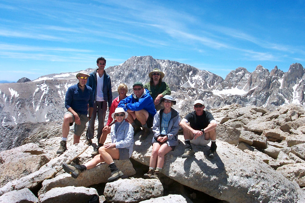 Group shot on Lone Pine Peak at 12,944 feet with Mount Langley in background.