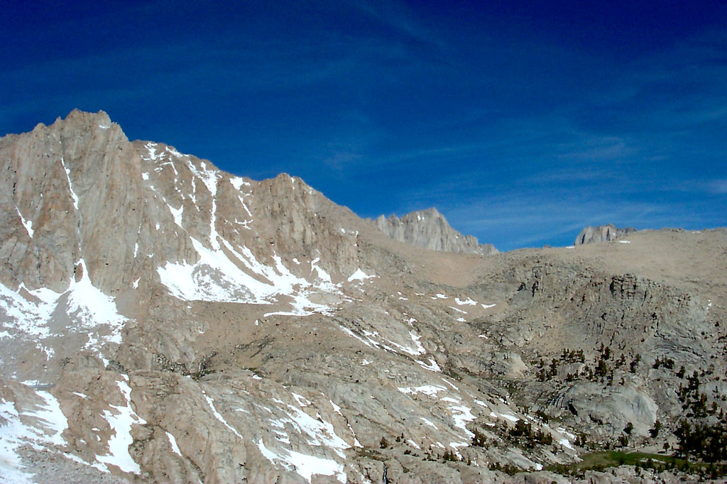 As we climb, the summit of Mount Whitney appears from behind a ridge.