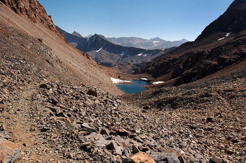 Looking back at an unnamed lake as I keep hiking towards McGee Pass.