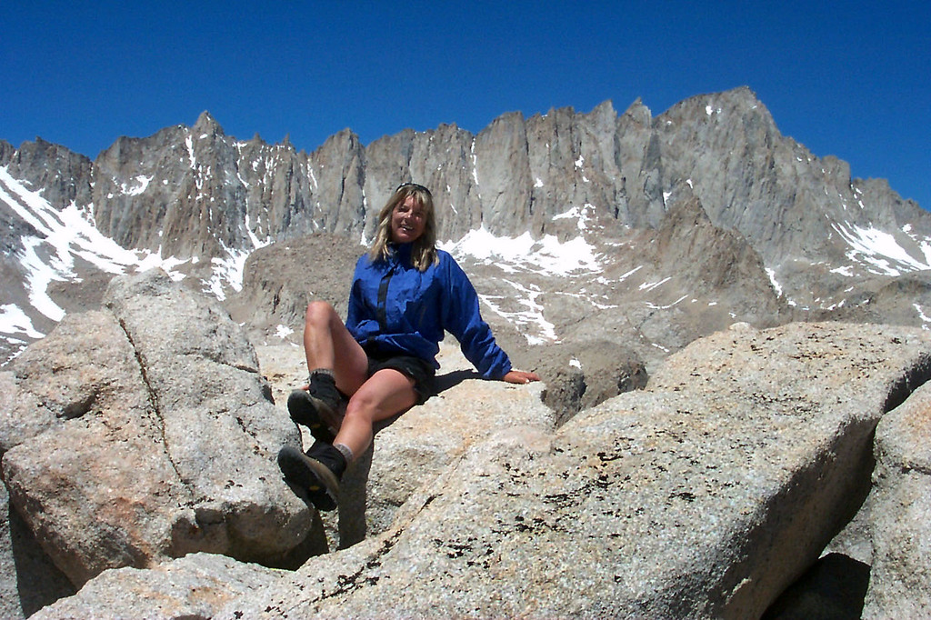 Sooz with Mount Muir at 14,015 feet and Mount Whitney at 14,495 feet to the west.