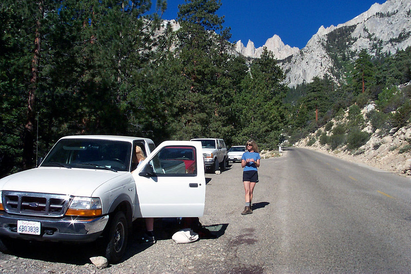 Kathy (in truck) and Sooz on the Whitney Portal Road, the start of our hike. Mount Whitney in background.