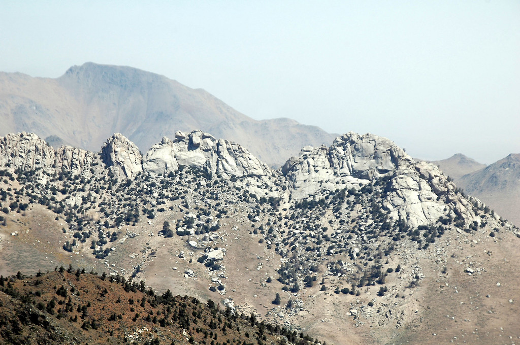 Zoomed in on the rock formations on the ridge.