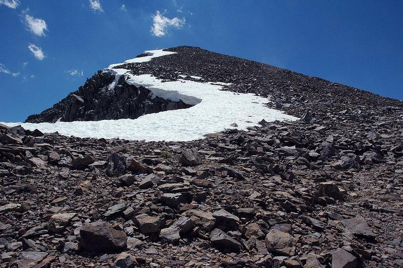 Snow cornice hanging over the edge.