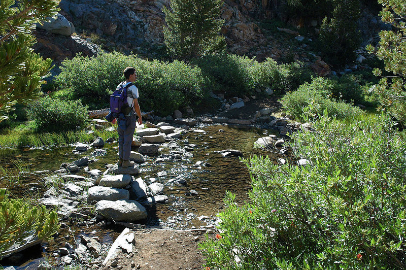 Jay gets his first view of Mount Goode from this stream crossing at Long Lake's outlet.