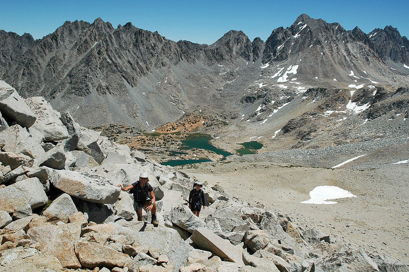 Sooz and Kathy with Bishop Lake below. Picture Puzzle on lelt and Mt Agassiz on right.