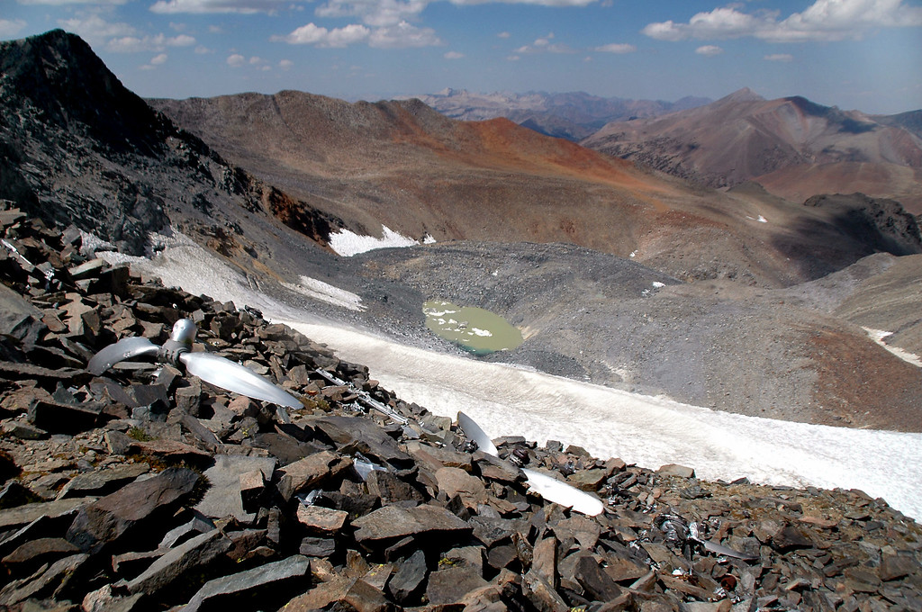 Looking down from the crash site to the lake at the base of the glacier.