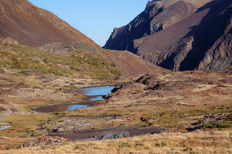 We set up camp in the rocky area above the lake about half a mile beyond the pass.