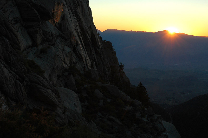 The sun rising from behind the Inyo Mountains.