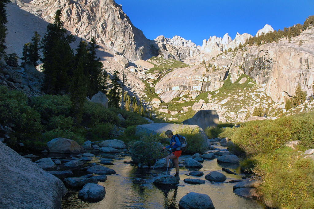 Sooz crossing the stream at the outlet to Lower Boy Scout Lake at 10,400'.