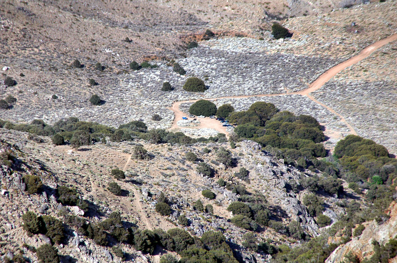 Zoomed in on the parking area from higher up the trail.