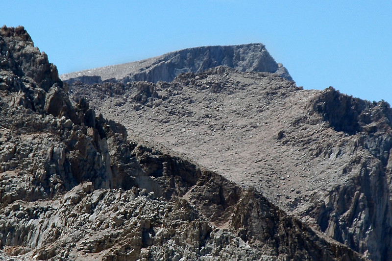 Zoomed in on the top of Mount Whitney at 14,494 feet and one of the Needles barely showing from behind a ridge.