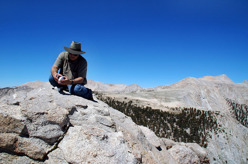 Tom signing the register on Owens Point at 11,375 feet.