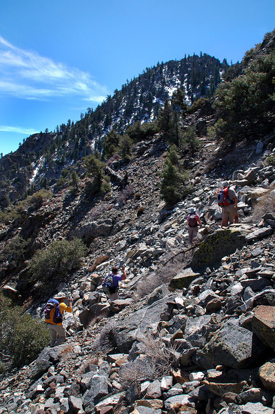 The group making their way over one of the few rock piles we had to hike over.