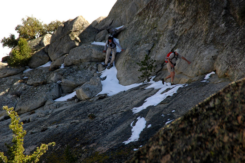 The guys crossing the friction slab just below the peak. Just out of view on the left is a big drop off.
